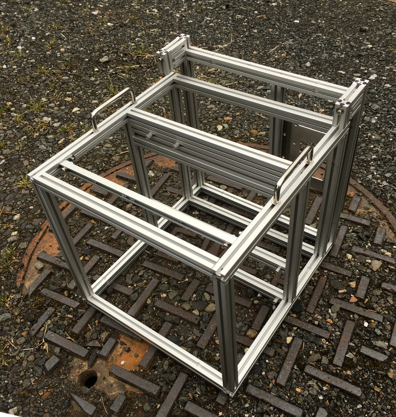 Custom computer case frame for a submerged liquid cooled rig.